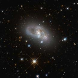 A história que uma galáxia espiral anã conta para nós
